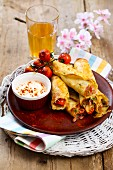 Pancakes filled with cheese, ham, mushrooms and chives served with oven-roasted tomatoes and sour cream