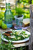 A salad with pears, rockets, Parmesan cheese and hazelnuts