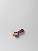 Psyllium seeds on a wooden spoon