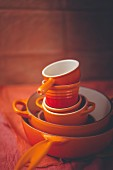 A stack of orange crockery