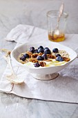 Energy muesli with yoghurt, dried figs, blueberries and honey