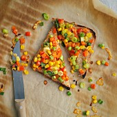 Toast topped with sweetcorn, peppers and spring onions