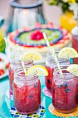 Summer fruit drinks in glasses on a table outside