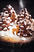 Chocolate pine cones with icing sugar and marshmallows