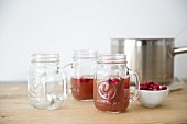 Mulled apple cider with cranberries in glass mugs