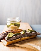 Baguette sandwich with pâté and cornichons