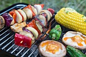 Vegetables and mushrooms on a barbecue