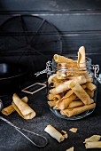 Freshly baked tuiles in a flip-top jar
