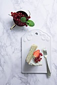 A slice of white cake decorated with berries