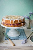Almond sponge cake with cherry jam on the cake stand
