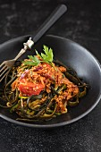 Vegan courgette and seaweed pasta with Bolognese sauce made from cracked lupine