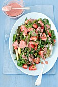 Asparagus and strawberry salad with vegetables and strawberry sauce