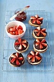 Biscuts with strawberry jam and chocolate