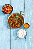 Lamb curry with tomatoes, mango chutney and raita