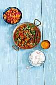 Lamb curry with tomatoes, mango chutney and raita