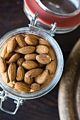Almonds in a flip-top jar