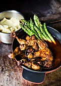 Coq au vin with asparagus and mashed potatoes