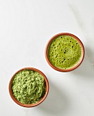 Matcha tea and tea powder into bowls (seen from above)