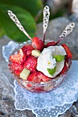 Strawberries with melon and whipped cream