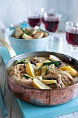 Chicken casserole with lemons, courgettes, olives and potatoes
