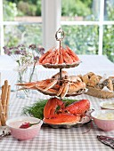 Various different crustaceans on the cake stand by laid table
