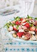 Salad with strawberries, ham, cheese and couscous