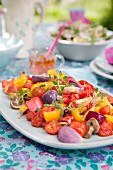 Warm pepper salad with red onions, tomatoes, mushrooms, garlic and fresh thyme