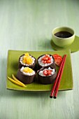 Chocolate sushi with mango and strawberries