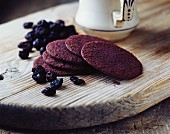 Blackcurrant biscuits on a rustic wooden board