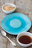 Mizu Shingen Mochi (Japanese raindrop cake) on a blue plate