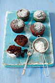 Chocolate muffins with jam and icing sugar