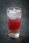 Red syrup with fizzy water