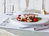 Trout fillet, lentil and apple salad with radishes for brunch