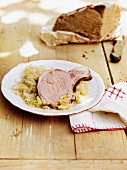 Gammon steak with sauerkraut and bread