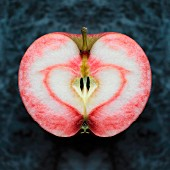 Half an apple with a heart-shaped in the flesh