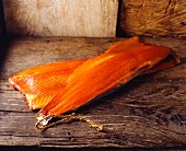 Smoked salmon on a wooden surface