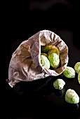 Brussels sprouts in a paper bag