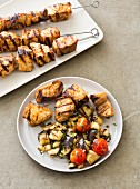 Grilled swordfish kebabs with aubergines and tomatoes