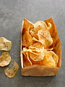 Potato crisps in a paper bag