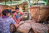 Potatoes being weighed at a market in Myanmar (Burma, south-east Asia)