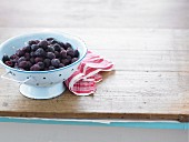 Frozen cherries in a colander