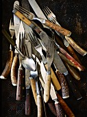Various old forks, spoons and knives (seen from above)