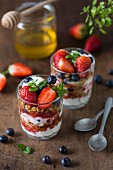 Granola with yoghurt parfait, strawberries and blueberries