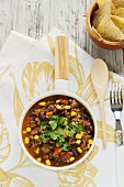 Chilli con carne with sweetcorn and coriander