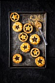 Christmas mince pies on a metal tray