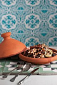 Lamb tagine with plums and almonds (Morocco)