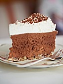 A slice of chocolate mousse cake with almonds