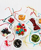 Various liquorice sweets in a white bowl with ribbons