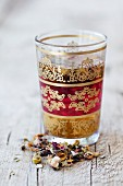 Lebanese flower tea in an oriental tea glass