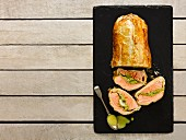 Salmon baked in pastry with leeks and lemongrass